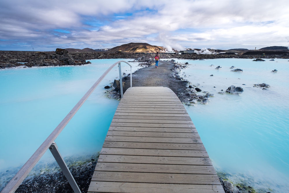 Impressive entrance to the Blue Lagoon Iceland with a bridge over turquoise water