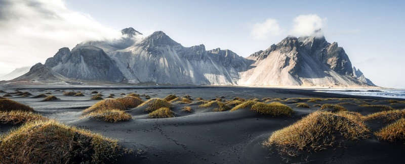 Beautiful shot of the vestrahorn mountain with the black sand beach in front of it