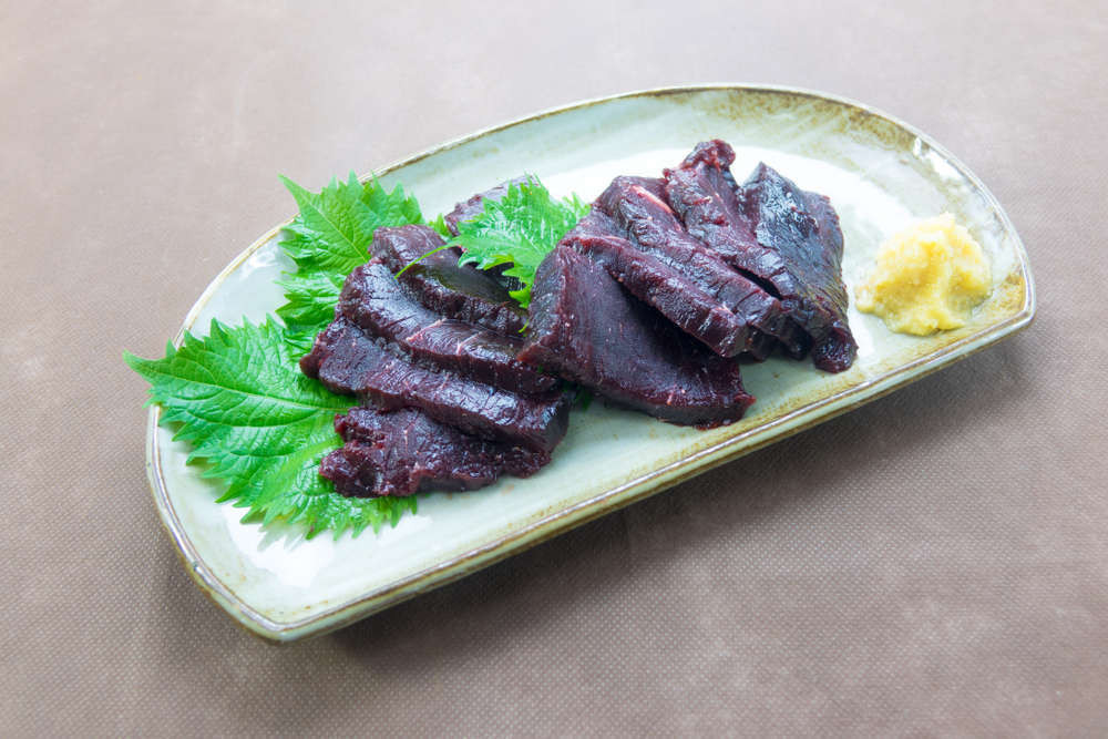 Whale meat served on a plate raw
