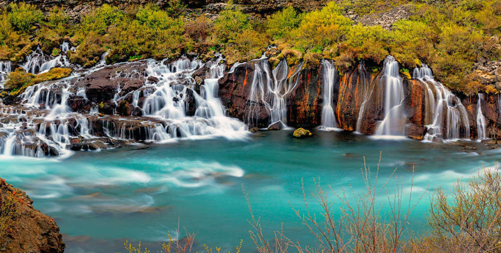 View of the Hraunfossar waterfalls during the fall season