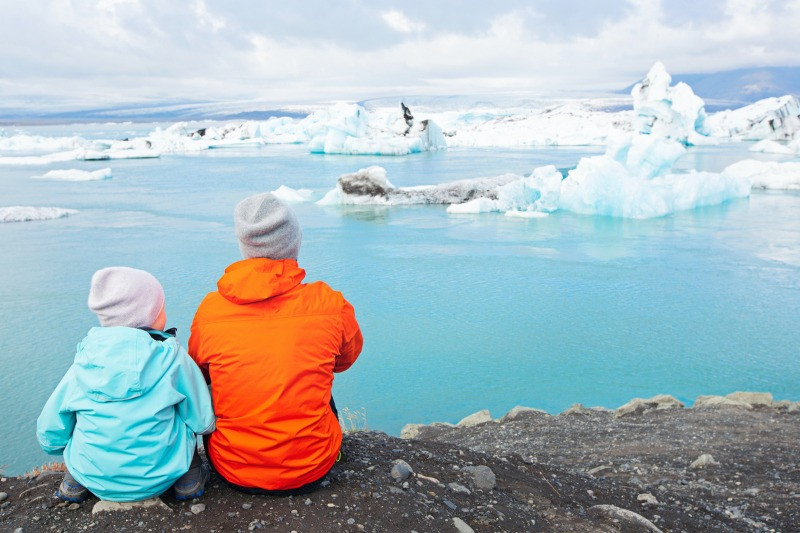 Family watching wildlife at Jokulsarlon glacier lagoon