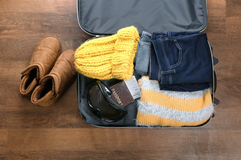 Iceland packing list suitcase with winter clothes
