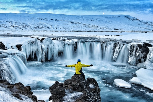 A man enjoying the impressive waterfalls of Iceland