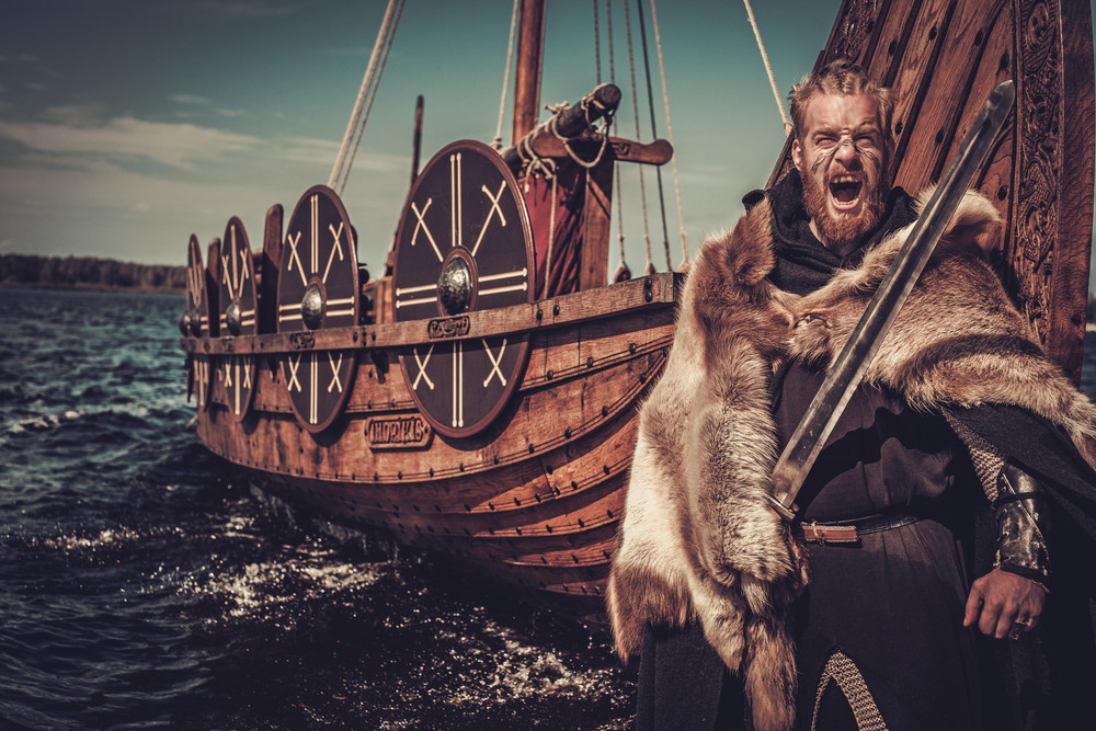 Viking getting off his boat. Vikings are the main compound of today's Iceland demographics