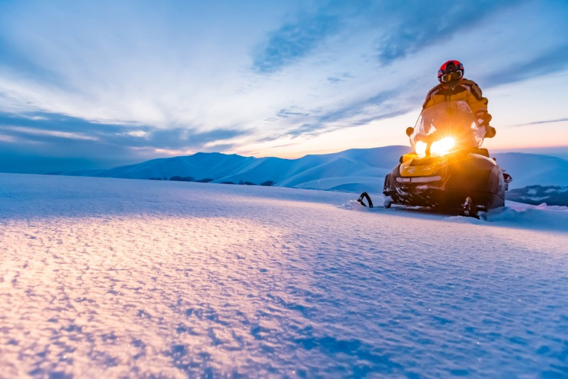 snowmobiling in Iceland right at the twilight