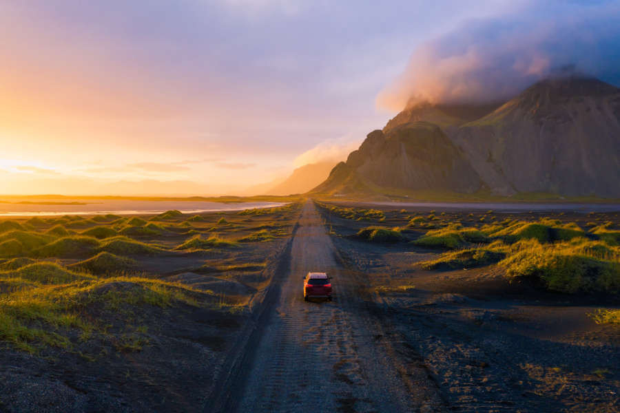 Rental vehicle driving through the beautiful landscapes of Iceland