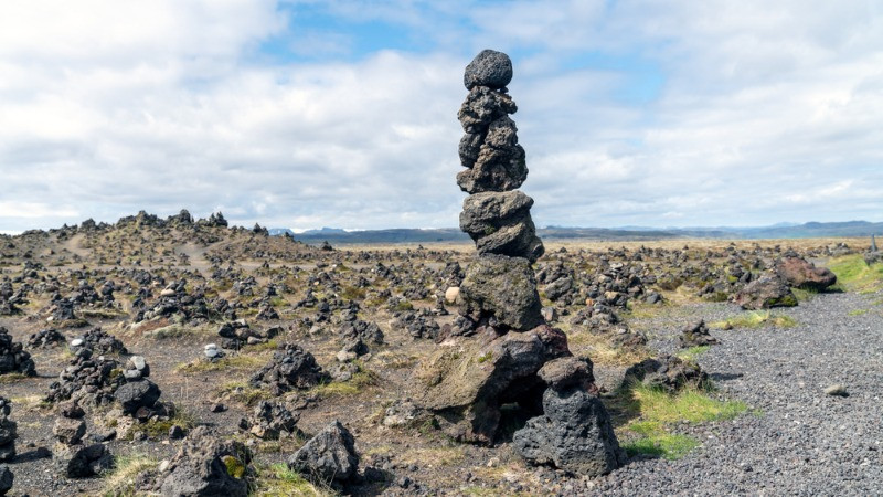 piled rocks in a lava field - cairns in Iceland