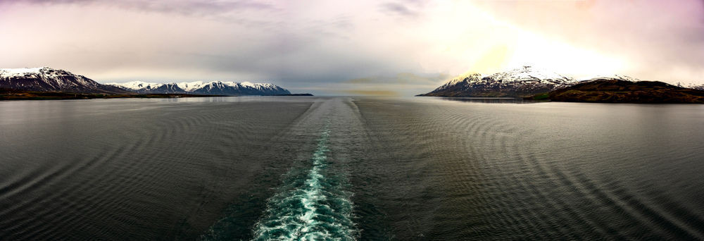 Iceland cruise liner sailing through a fjord
