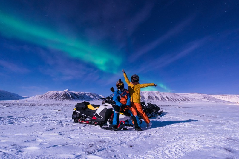 snowmobiling under the northern lights in Iceland