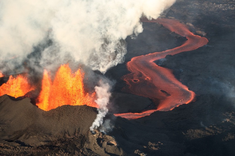 Iceland volcano activity at a fissure with lava flowing