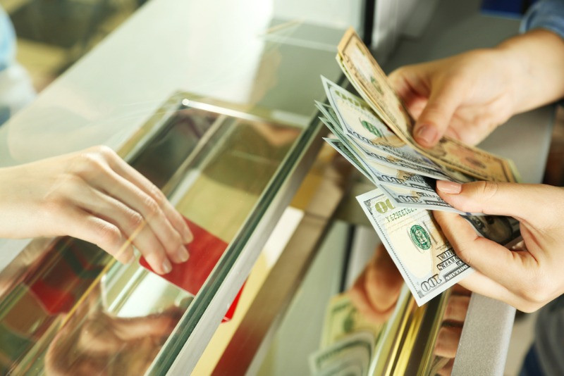 woman changing dollars for icelandic currency at a exchange office