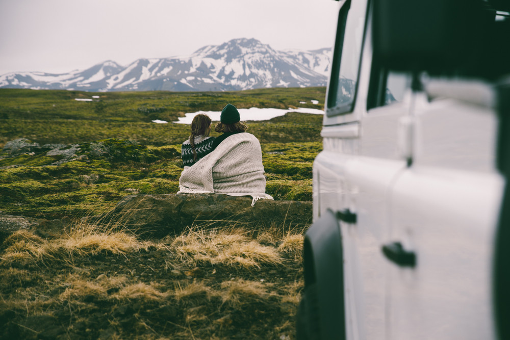 couple with a blanket staring at the views- camper van's heating system