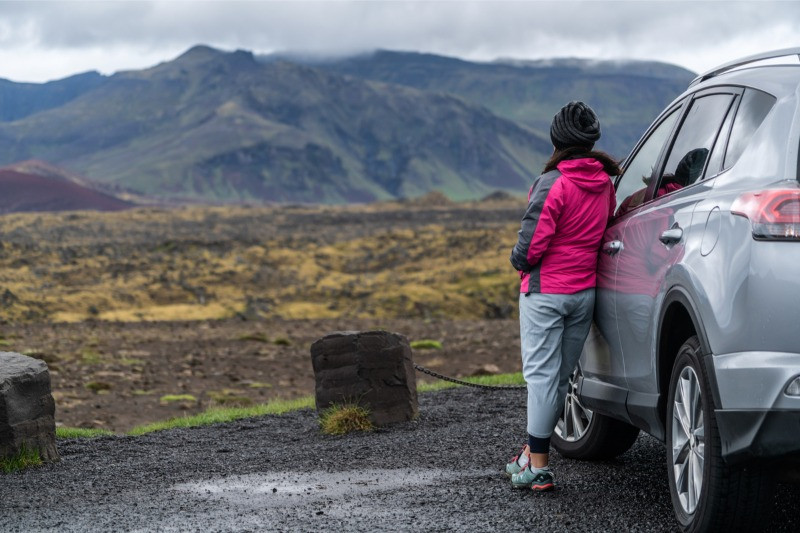 Woman driving to Kerid crater in Iceland car rental