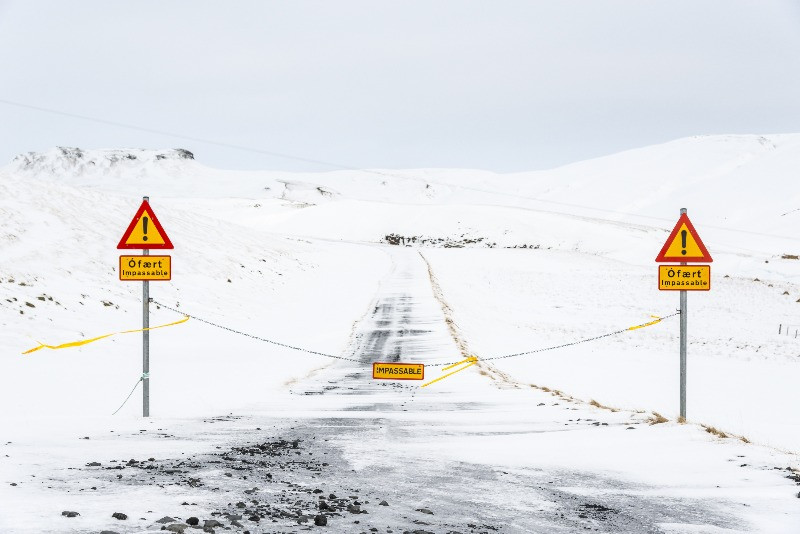 road closures informed with traffic signs and chains