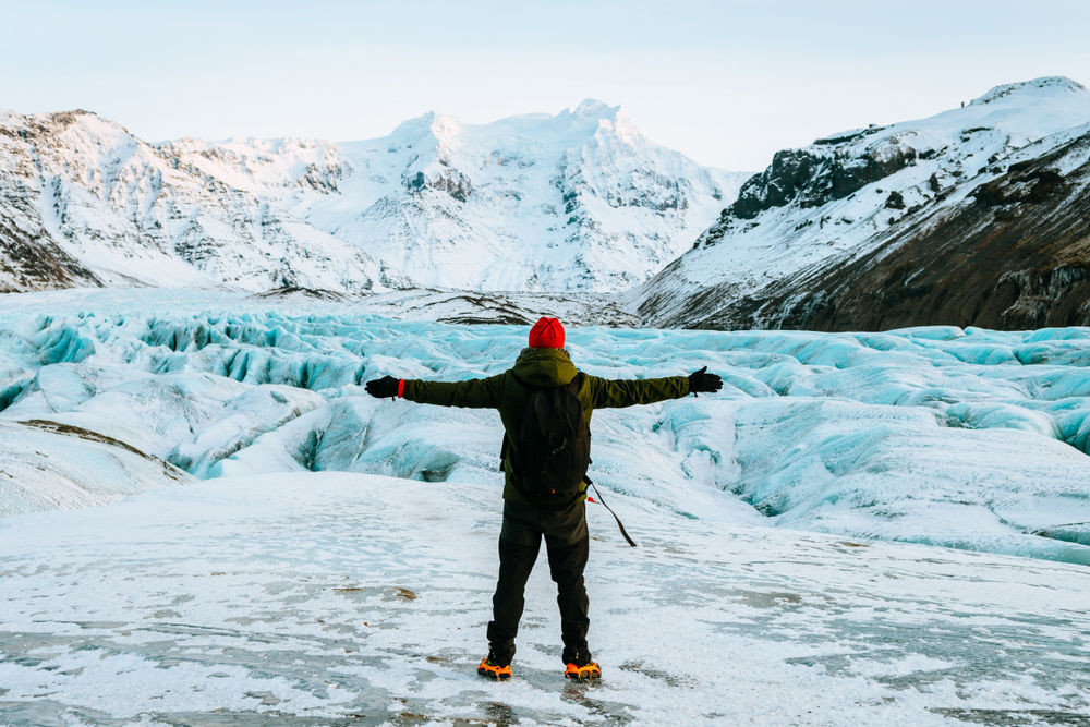 Traveler at the summit of a glacier in Iceland