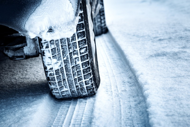 close up picture of winter and snow tires to drive in Iceland