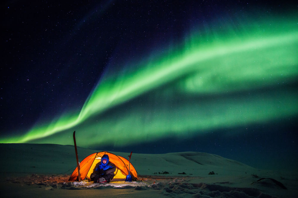 Camping in Iceland under the impressive Northern Lights