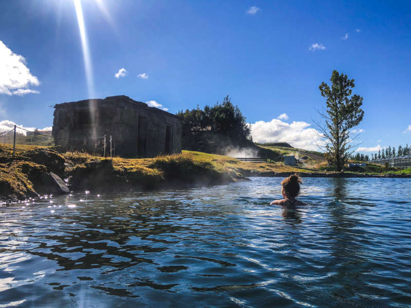 the secret lagoon in a sunny day in Iceland