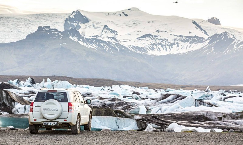 Suzuki standard car rental 4x4 model in Iceland's glacier lagoon