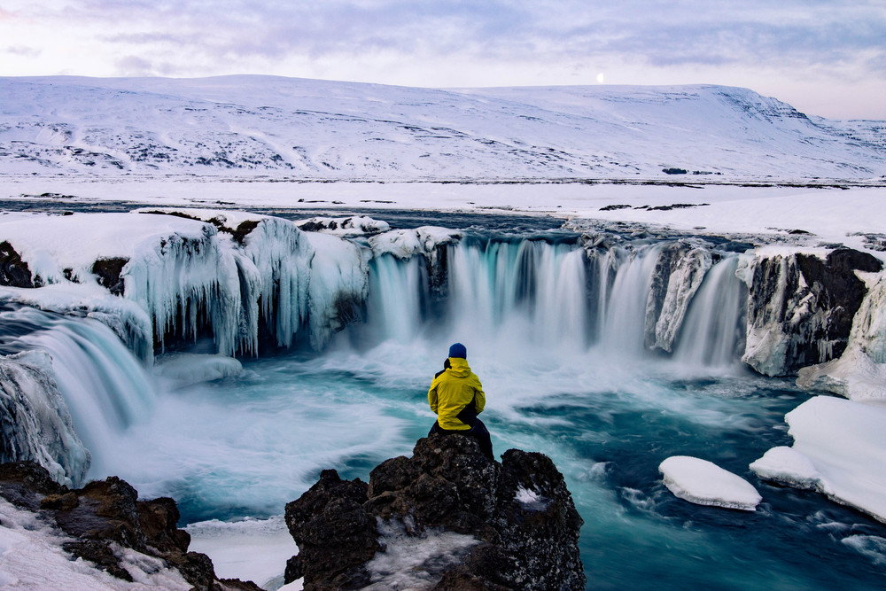 A visitor enjoying Iceland in Winter, a great time to visit Iceland