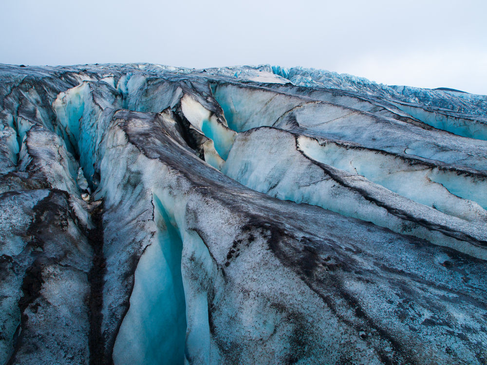 Glacier with ash from volcanic eruptions in Iceland