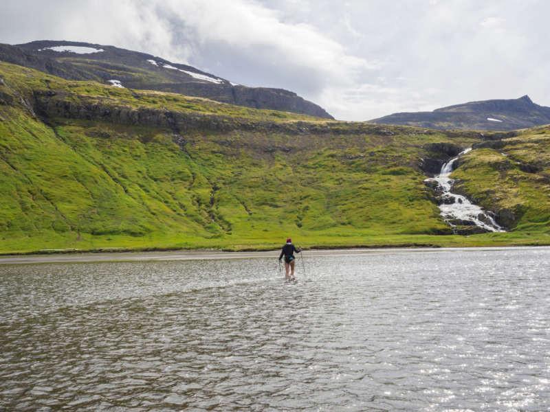 hiker crossing a river to get to Hornstrandir