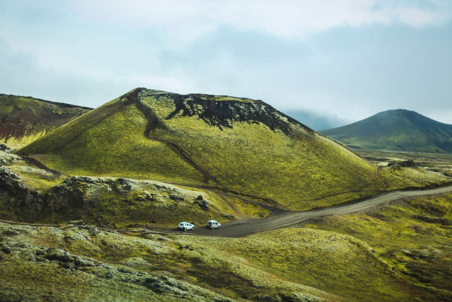 Two vehicles through the Highlands' road following the icelandic traffic law