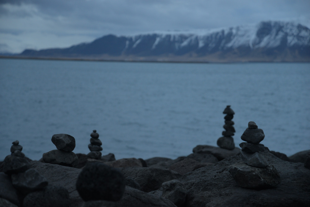 Cairns in Iceland built by a fjord