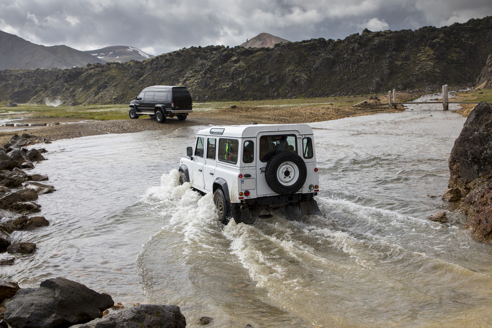 jeep crossing a river in Iceland's highlands