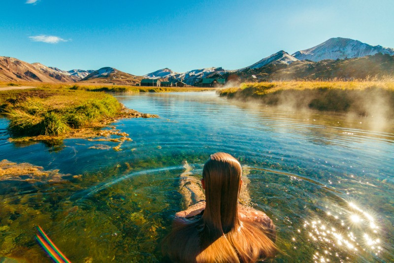 woman taking a bath on her own in geothermal heated waters