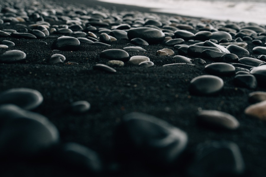 Volcanic stones on the black sand beach Iceland