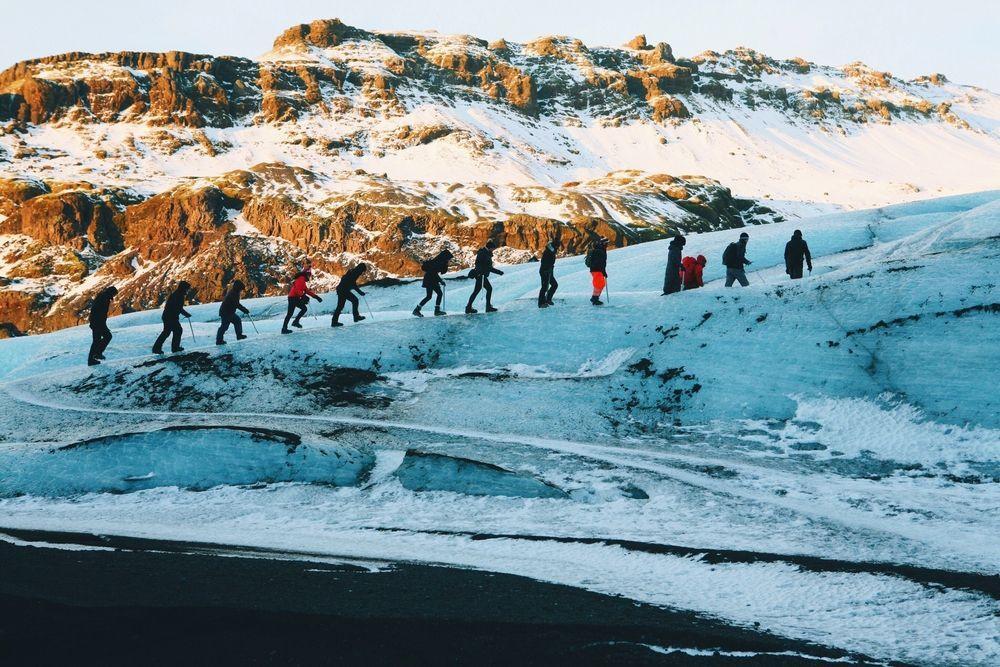 group of tourist hiking on a glacier