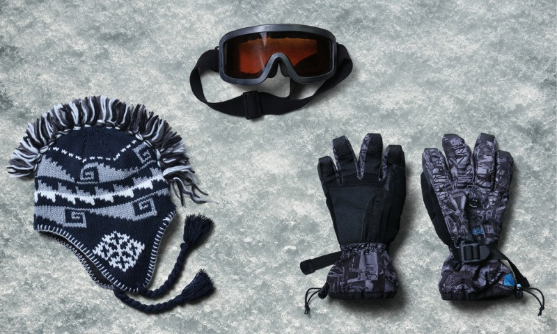 snow sledding equipment: gloves, glasses and beanie.