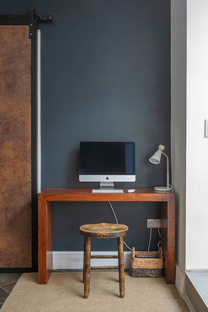 Study area by bespoke sliding barn door.