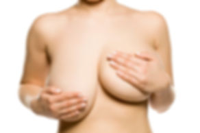 A woman with univen big breasts on white