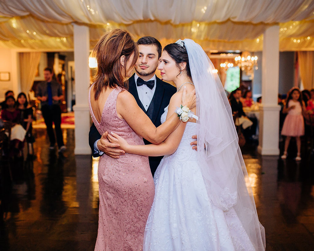 mother son and daughter-in-law special moment at the mansion at valley country club