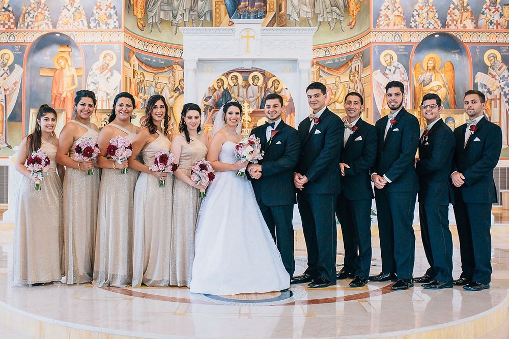 wedding party inside saint mary antiochian church