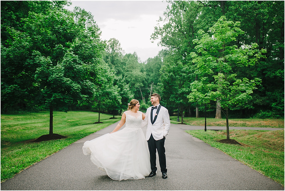 Spring Bridal and Groom Portraits while bride twirls her wedding gown - Annapolis Wedding Photographer