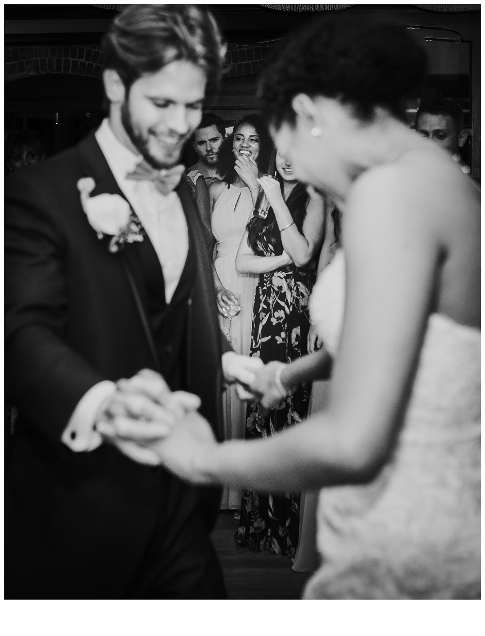 Watching your best friend dancing her first dance as a wife. Candid portrait by Katherine Elizabeth Photography - Baltimore Wedding Photographer