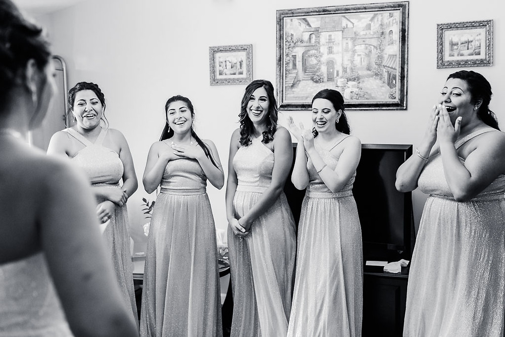 bridesmaids see bride in her wedding dress for the first time