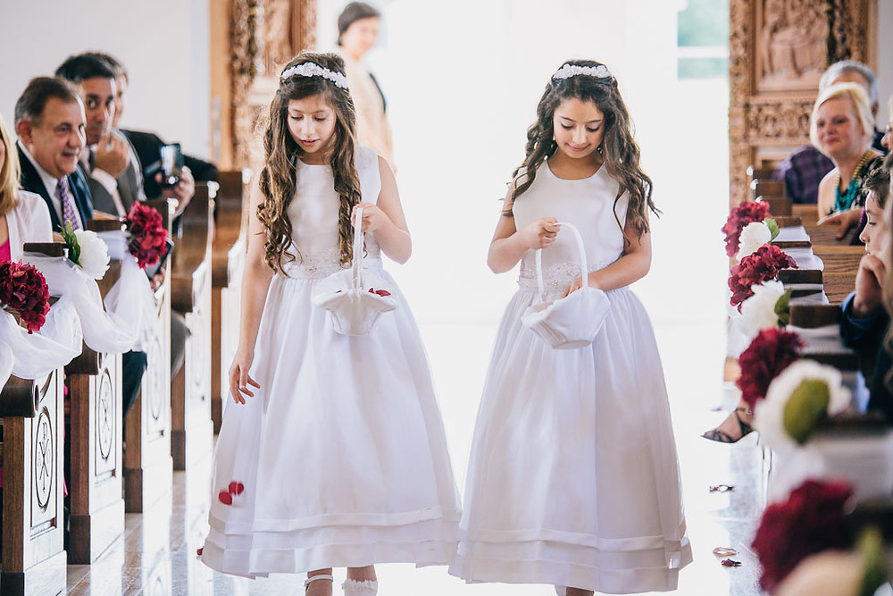 flower girls dropping petals at saint mary's antiochian church