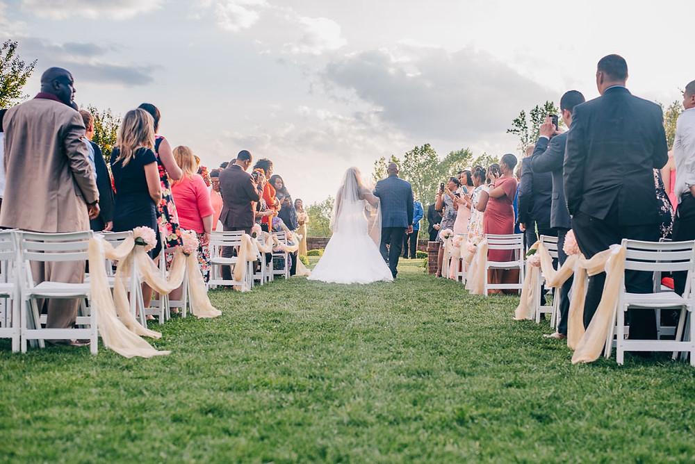 Walking down the aisle - Oxon Hill Manor Wedding