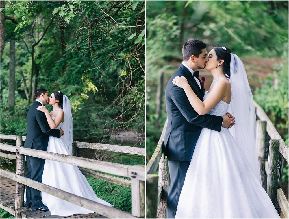 Kisses at oregon ridge bridal portraits on walking bridge in the trees