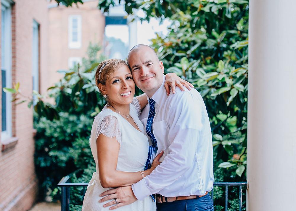 couple smiling rainy day wedding