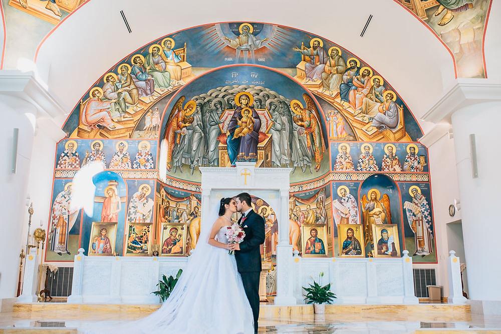 bride and groom inside saint mary antiochian church
