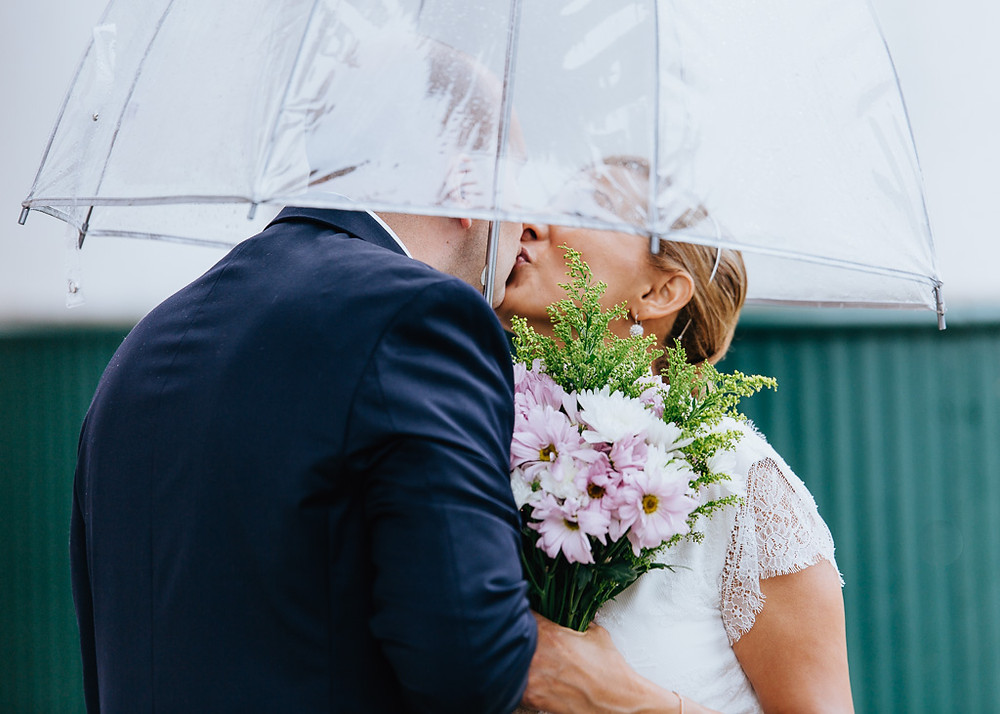 Sneaking a Kiss under an Umbrella - Charles Town Courthouse Wedding - Maryland Wedding Photographer - Katherine Elizabeth Photography