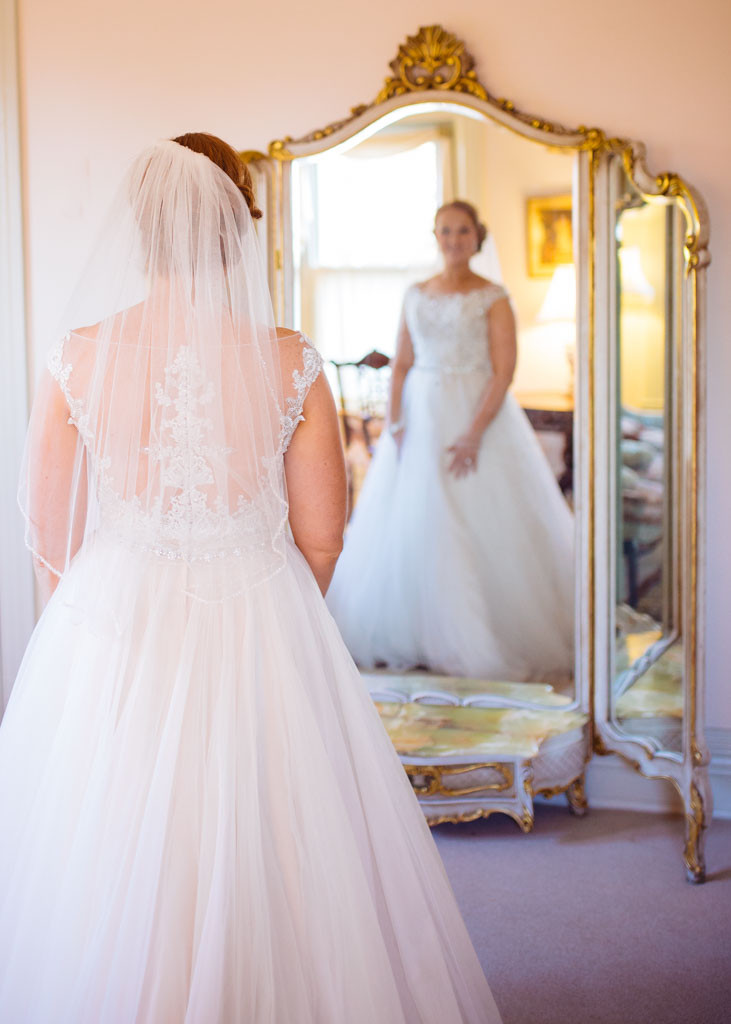 Bride looking at her reflection Ceresville Mansion