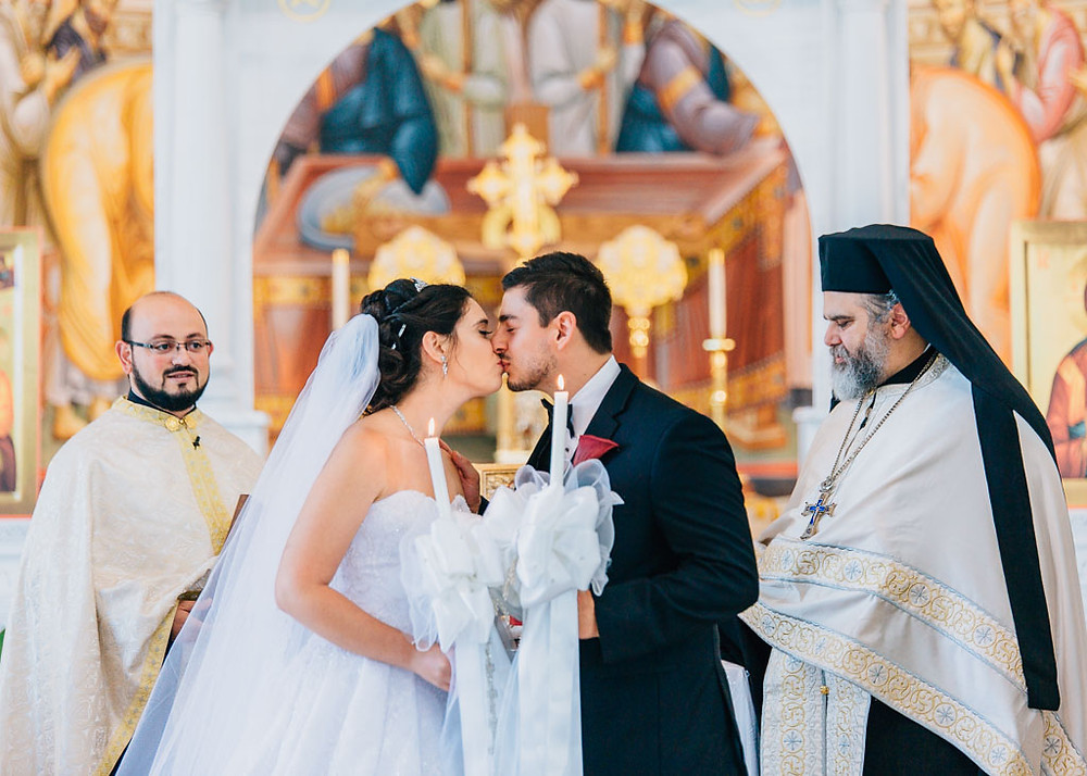 first kiss of the bride and groom greek orthodox wedding baltimore maryland