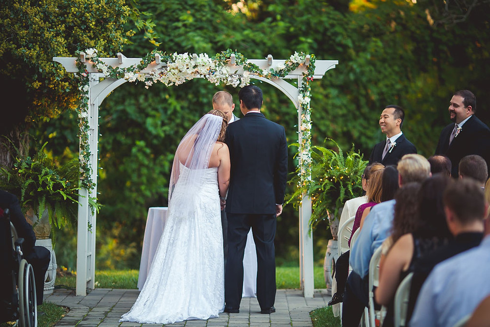 Bride and groom Arch Overhills Mansion
