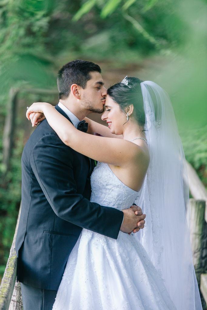 forehead kiss oregon ridge bridal portraits on walking bridge in the trees